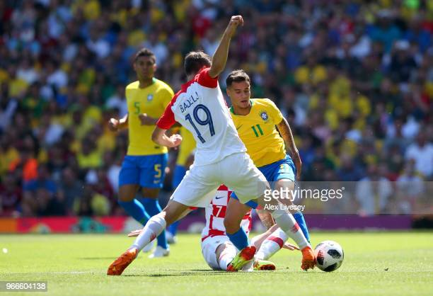 Philippe Coutinho of Brazil is challenged by Antonion Milic of Croatia during the International Friendly match between Croatia and Brazil at Anfield...
