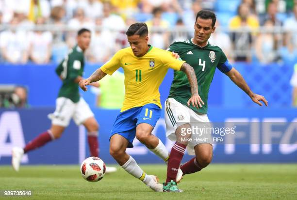 50174b290 Philippe Coutinho of Brazil is challenged by Rafael Marquez of Mexico  during the 2018 FIFA World