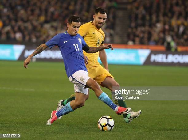 Philippe Coutinho of Brazil is pressured by Bailey Wright of Australia during the Brasil Global Tour match between Australian Socceroos and Brazil at...