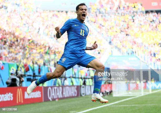 Philippe Coutinho of Brazil jumps in the air as he celebrates scoring the opening goal during the 2018 FIFA World Cup Russia group E match between...