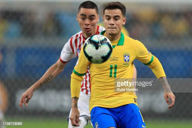 Philippe Coutinho of Brazil looks at the ball against Miguel Almiron of Paraguay during the Copa America Brazil 2019 quarterfinal match between...