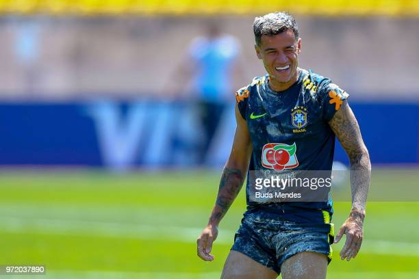 Philippe Coutinho of Brazil reacts after having eggs smashed on his head as a birthday prank during a Brazil training session ahead of the FIFA World...