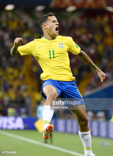 Philippe Coutinho of Brazil reacts after scoring the first goal against Switzerland during the first half of a World Cup group stage match in the...