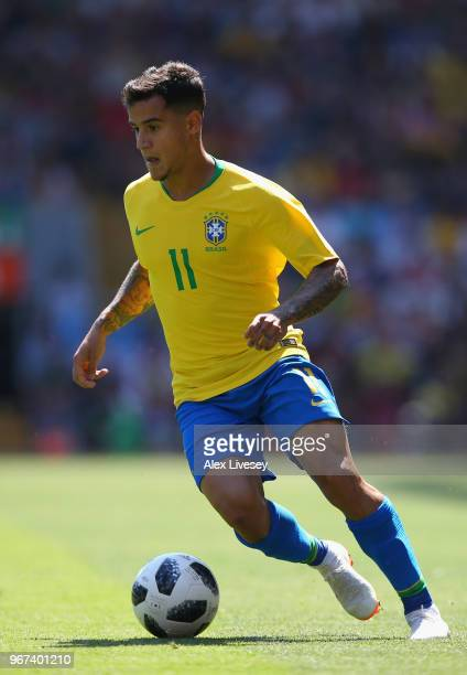 Philippe Coutinho of Brazil runs the ball during the International friendly match between of Croatia and Brazil at Anfield on June 3, 2018 in...