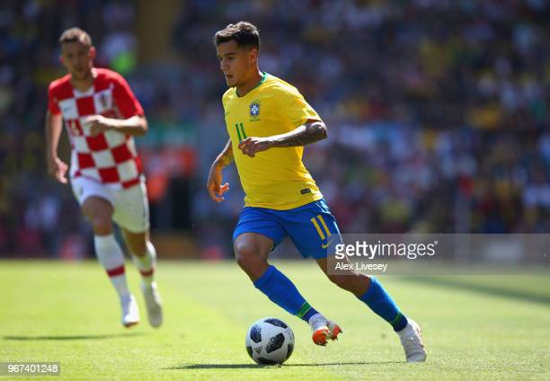 Philippe Coutinho of Brazil runs the ball during the International friendly match between of Croatia and Brazil at Anfield on June 3 2018 in...