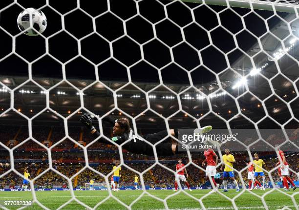 Philippe Coutinho of Brazil scores his team's first goal past Yann Sommer of Switzerland during the 2018 FIFA World Cup Russia group E match between...