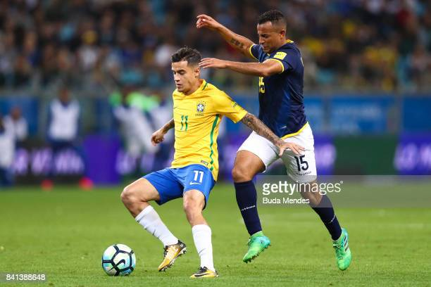Philippe Coutinho of Brazil struggles for the ball with Pedro Quinonez of Ecuador during a match between Brazil and Ecuador as part of 2018 FIFA...