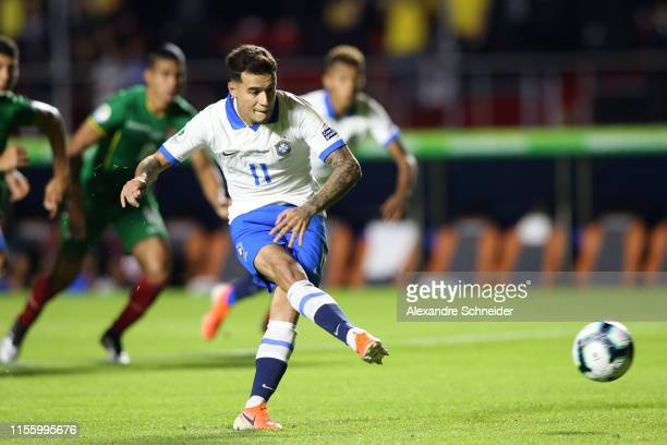 Philippe Coutinho of Brazil takes a penalty kick to score the opening goal during the Copa America Brazil 2019 group A match between Brazil and...