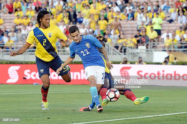 Philippe Coutinho of Brazil takes a shot on goal against Juan Carlos Paredes and Arturo Mina of Ecuador during the first half of the 2016 Copa...