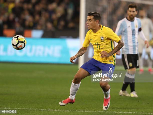Philippe Coutinho of Brazil watches the ball during the Brazil Global Tour match between Brazil and Argentina at Melbourne Cricket Ground on June 9...