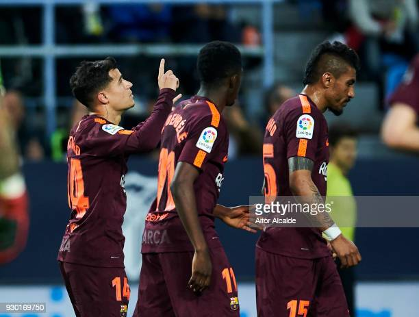 Philippe Coutinho of FC Barcelona celebrates after scoring his team's second goal during the La Liga match between Malaga and Barcelona at Estadio La...