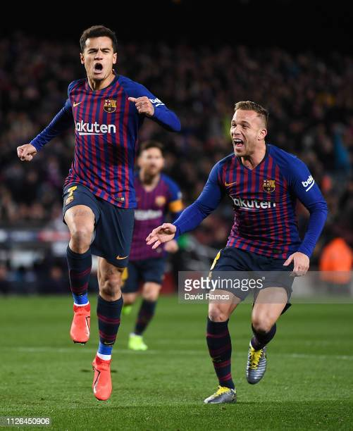 Philippe Coutinho of FC Barcelona celebrates with his team mate Arthur Melo after scoring his team's first goal the Copa del Quarter Final match...