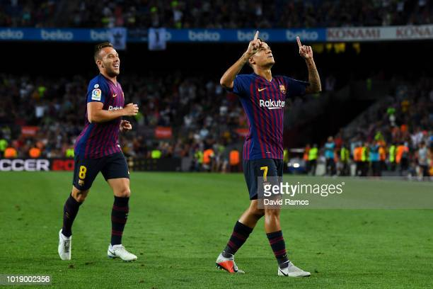 Philippe Coutinho of FC Barcelona celebrates with his team mate Arthur of FC Barcelona after scoring his team's second goal during the La Liga match...