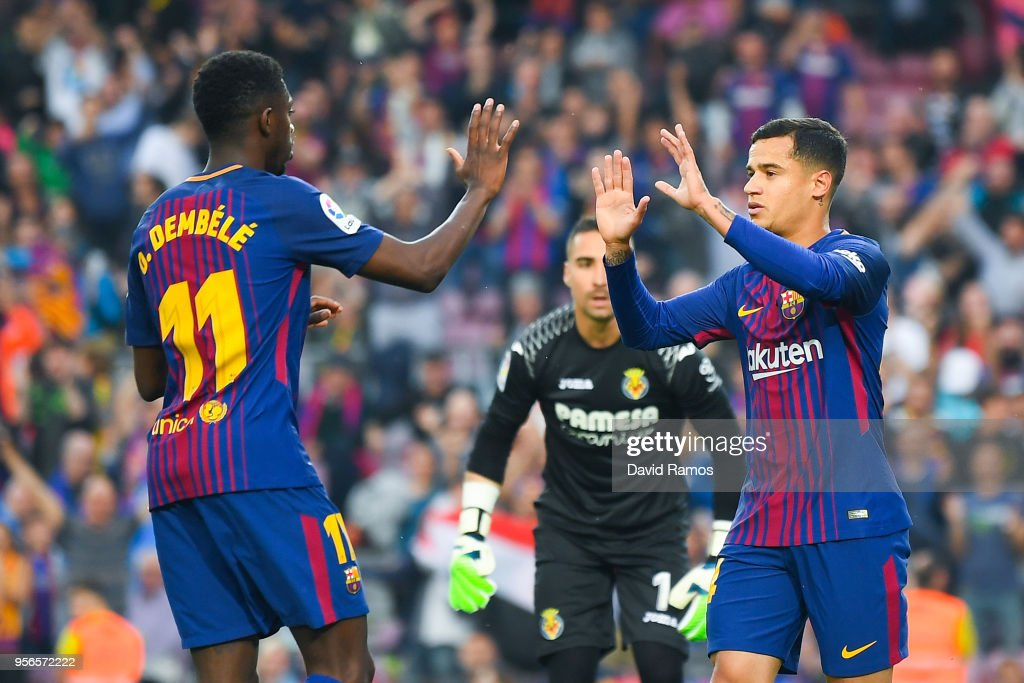 Philippe Coutinho (R) of FC Barcelona celebrates with his team mate Oussame Dembele after scoring his team's first goal the La Liga match between Barcelona and Real Madrid at Camp Nou on May 9, 2018 in Barcelona, Spain.