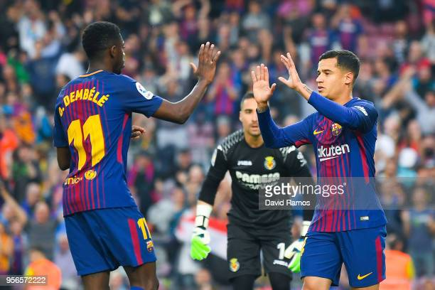 Philippe Coutinho of FC Barcelona celebrates with his team mate Oussame Dembele after scoring his team's first goal the La Liga match between...