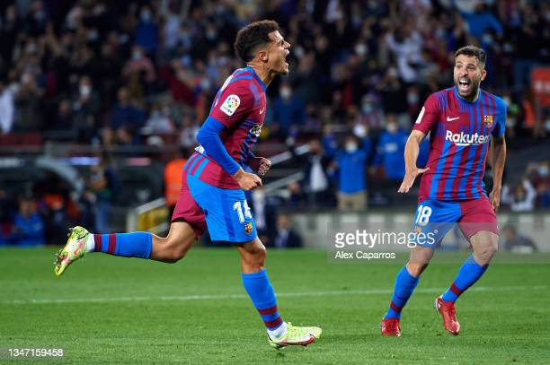Philippe Coutinho of FC Barcelona celebrates with his teammate Jordi Alba after scoring their team's third goal during the LaLiga Santander match...