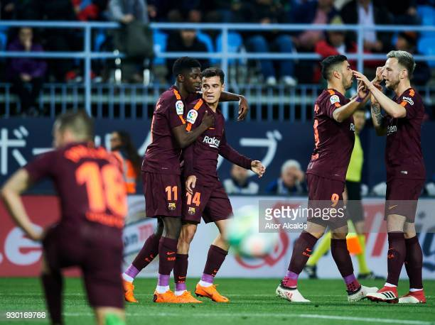 Philippe Coutinho of FC Barcelona celebrates with his teammates Ousmane Dembele of FC Barcelona after scoring his team's second goal during the La...