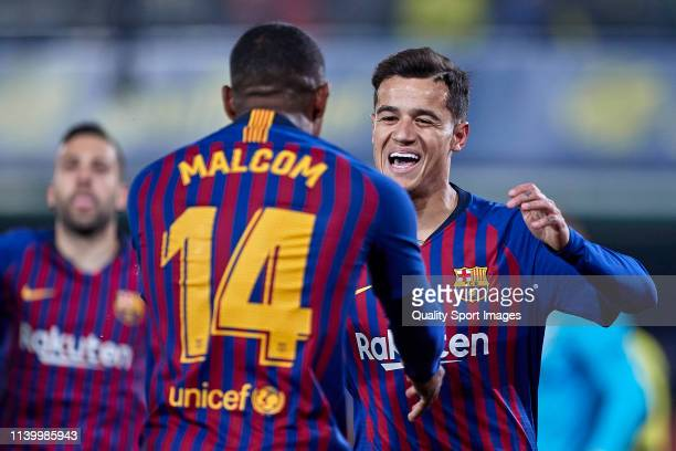 Philippe Coutinho of FC Barcelona celebrates with Malcom of FC Barcelona after scoring his team's first goal during the La Liga match between...
