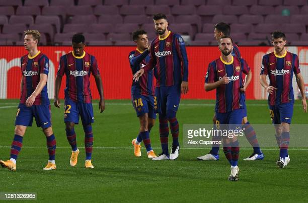 Philippe Coutinho of FC Barcelona celebrates with teammates after scoring his sides third goal during the UEFA Champions League Group G stage match...