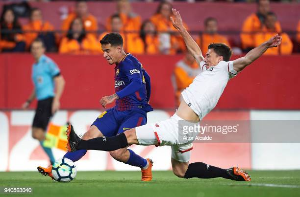 Philippe Coutinho of FC Barcelona competes for the ball with Clement Lenglet of Sevilla FC during the La Liga match between Sevilla CF and FC...