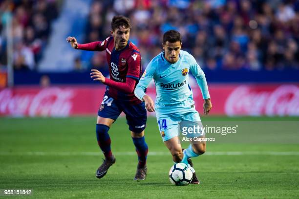 Philippe Coutinho of FC Barcelona conducts te ball past Jose Campana of Levante UD during the La Liga match between Levante UD and FC Barcelona at...