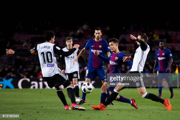 Philippe Coutinho of FC Barcelona conducts the ball among Daniel Parejo and Nemanja Maksimovic of Valencia CF during the Copa del Rey semifinal first...