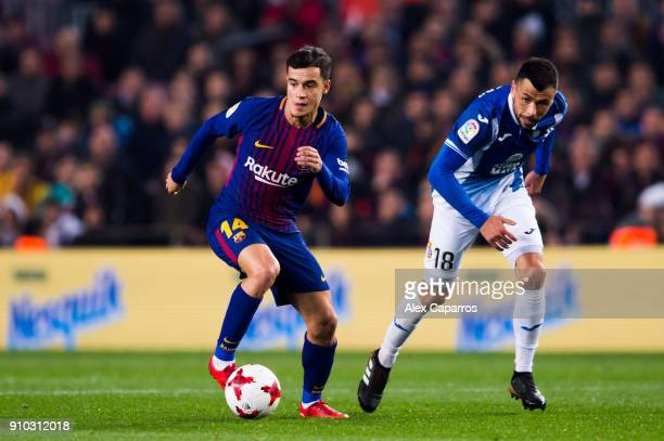 Philippe Coutinho of FC Barcelona conducts the ball past Javi Fuego of RCD Espanyol during the Spanish Copa del Rey Quarter Final Second Leg match...