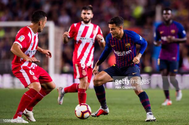 Philippe Coutinho of FC Barcelona dribbles Alex Granell of Girona FC during the La Liga match between FC Barcelona and Girona FC at Camp Nou on...
