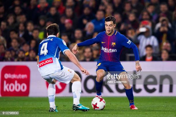 Philippe Coutinho of FC Barcelona dribbles Victor Sanchez of RCD Espanyol during the Spanish Copa del Rey Quarter Final Second Leg match between FC...