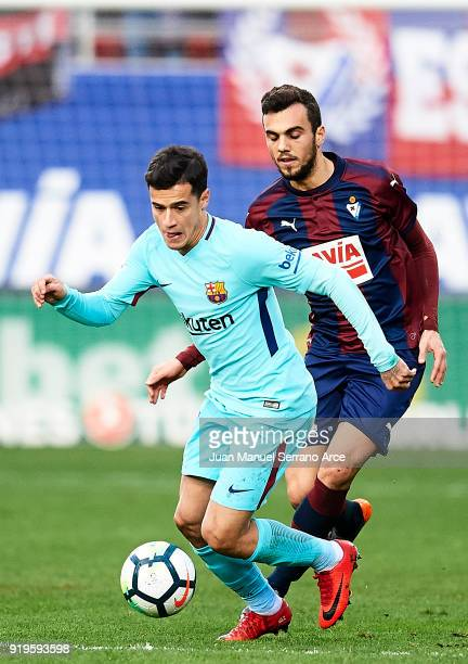 Philippe Coutinho of FC Barcelona duels for the ball with Joan Jordan of SD Eibar during the La Liga match between SD Eibar and FC Barcelona at...