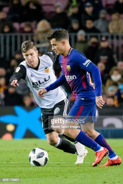 Philippe Coutinho of FC Barcelona fights for the ball with Luciano Vietto of Valencia CF during the Copa Del Rey 201718 match between FC Barcelona...