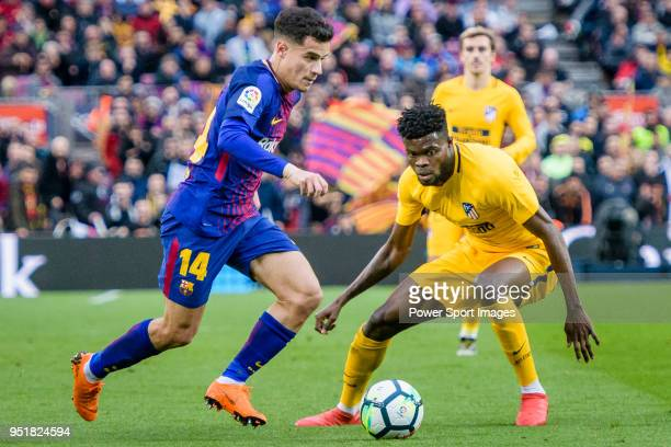 Philippe Coutinho of FC Barcelona fights for the ball with Thomas Teye Partey of Atletico de Madrid during the La Liga 201718 match at Camp Nou...