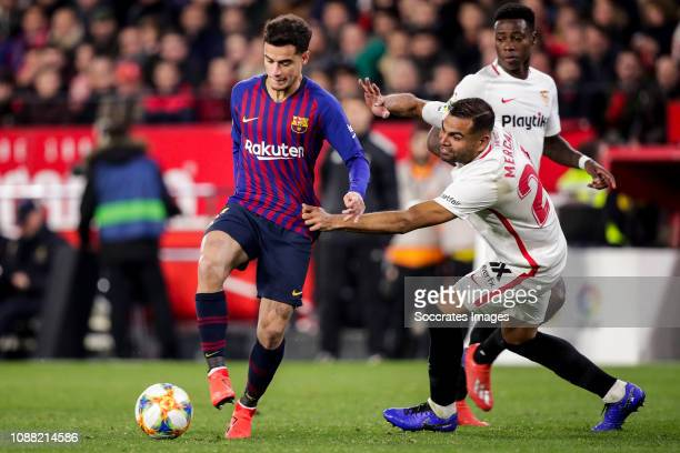 Philippe Coutinho of FC Barcelona Gabriel Mercado of Sevilla FC Quincy Promes of Sevilla FC during the Spanish Copa del Rey match between Sevilla v...