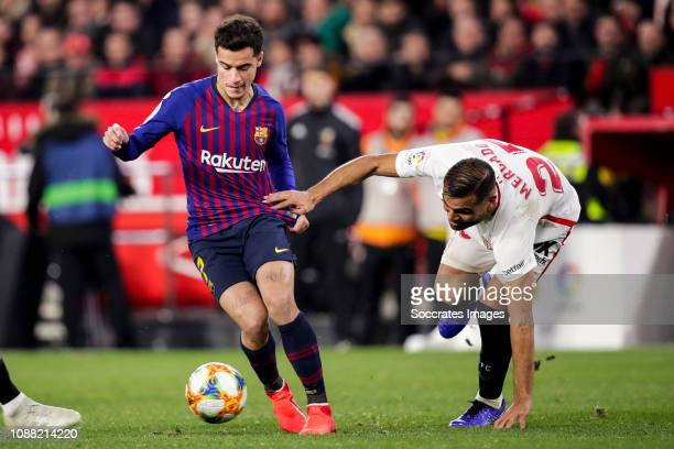 Philippe Coutinho of FC Barcelona Gabriel Mercado of Sevilla FC during the Spanish Copa del Rey match between Sevilla v FC Barcelona at the Estadio...