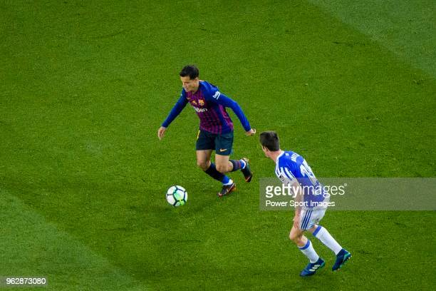Philippe Coutinho of FC Barcelona in action against Aritz Elustondo of Real Sociedad during the La Liga match between Barcelona and Real Sociedad at...