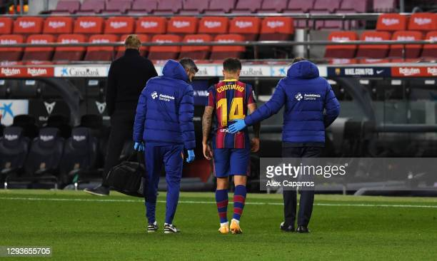 Philippe Coutinho of FC Barcelona leaves the pitch after getting injured during the La Liga Santander match between FC Barcelona and SD Eibar at Camp...