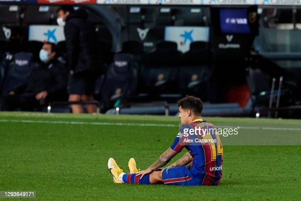 Philippe Coutinho of FC Barcelona lies injured during the La Liga Santander match between FC Barcelona and SD Eibar at Camp Nou on December 29, 2020...