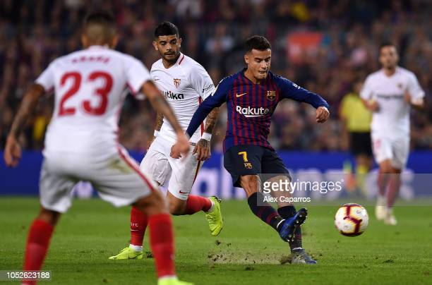 Philippe Coutinho of FC Barcelona looks to shoot under pressure during the La Liga match between FC Barcelona and Sevilla FC at Camp Nou on October...