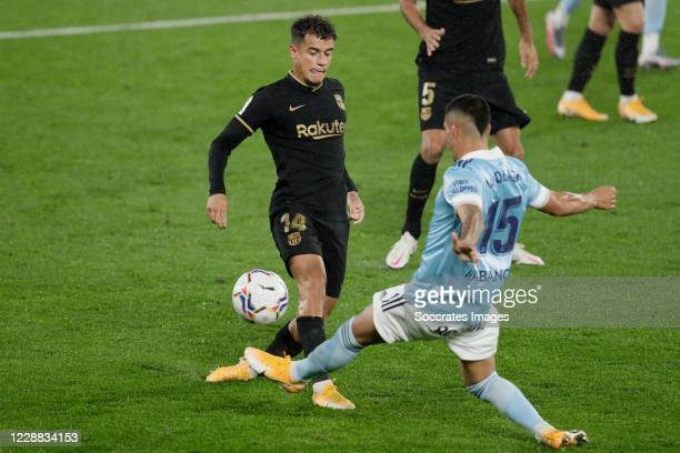 Philippe Coutinho of FC Barcelona Lucas Olaza of Celta de Vigo during the La Liga Santander match between Celta de Vigo v FC Barcelona at the Estadio...