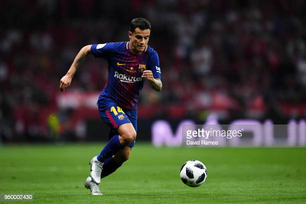 Philippe Coutinho of FC Barcelona runs with the ball during the Spanish Copa del Rey Final match between Barcelona and Sevilla at Wanda Metropolitano...