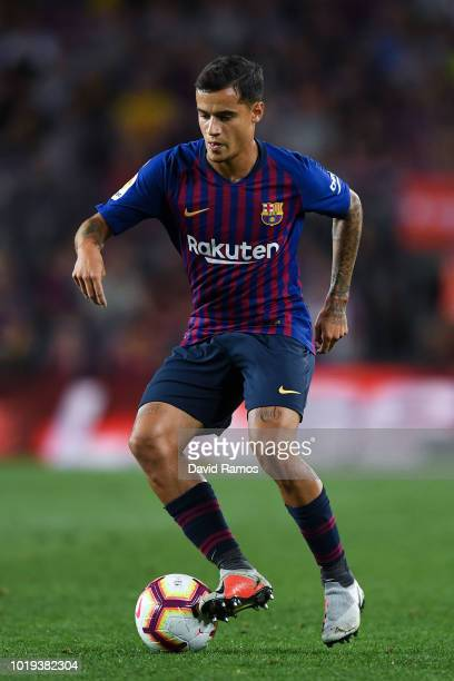 Philippe Coutinho of FC Barcelona runs with the ball during the La Liga match between FC Barcelona and Deportivo Alaves at Camp Nou on August 18 2018...