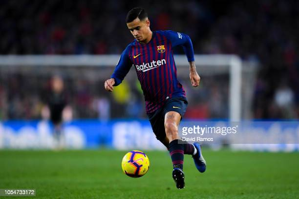 Philippe Coutinho of FC Barcelona runs with the ball during the La Liga match between FC Barcelona and Real Madrid CF at Camp Nou on October 28 2018...