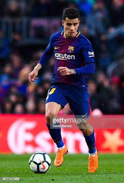 Philippe Coutinho of FC Barcelona runs with the ball during the La Liga match between Barcelona and Atletico Madrid at Camp Nou on March 4 2018 in...