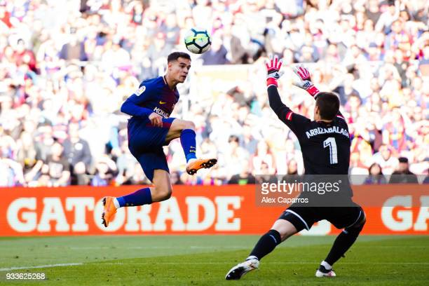 Philippe Coutinho of FC Barcelona sends the ball over Kepa Arrizabalaga of Athletic Club during the La Liga match between Barcelona and Athletic Club...