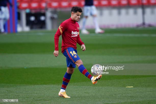 Philippe Coutinho of FC Barcelona warms up prior the La Liga Santander match between FC Barcelona and Valencia CF at Camp Nou on December 19, 2020 in...