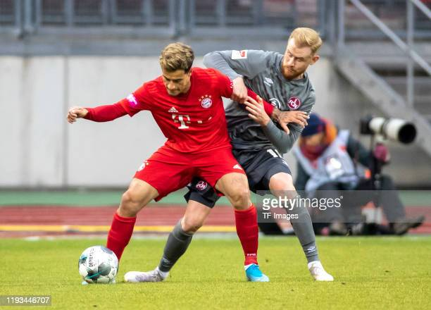 Philippe Coutinho of FC Bayern Muenchen and Sebastian Kerk of 1.FC Nuernberg battle for the ball during a friendly match between 1. FC Nuernberg and...