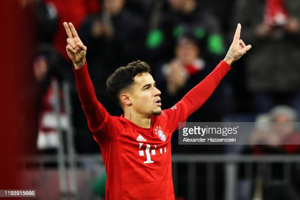 Philippe Coutinho of FC Bayern Muenchen celebrates scoring his sides first goal during the Bundesliga match between FC Bayern Muenchen and SV Werder...