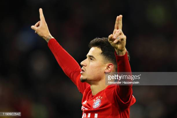 Philippe Coutinho of FC Bayern Muenchen celebrates scoring his sides third goal during the Bundesliga match between FC Bayern Muenchen and SV Werder...