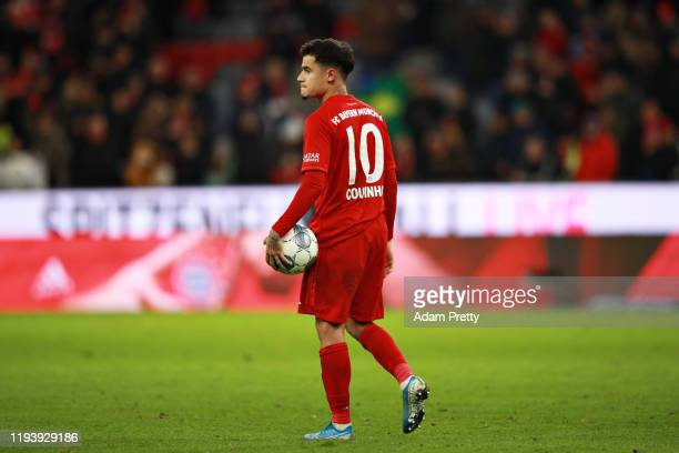 Philippe Coutinho of FC Bayern Muenchen holds the match ball after scoring a hattrick during the Bundesliga match between FC Bayern Muenchen and SV...