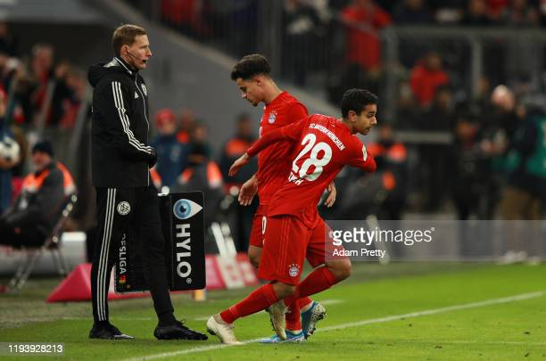Philippe Coutinho of FC Bayern Muenchen is replaced as a substitute by teammate Sarpreet Singh during the Bundesliga match between FC Bayern Muenchen...